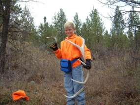 Here is Adam on opening day in Montana in 2001. He was too young to carry a rifle but we found these antlers while we were out hunting.