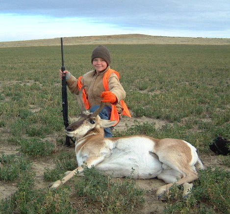 Adam with his first antelope. A nice buck he shot with a .243 at about 200 yards.