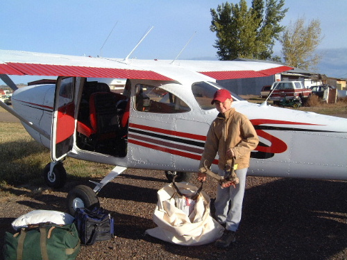 Loading the Cessna T41B at the Broadus, Montana airport following our 2002 antelope hunt.