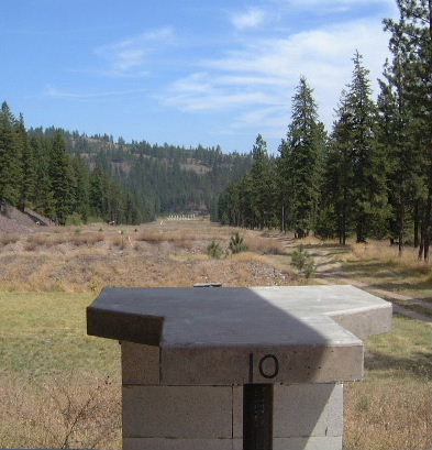 Looking down-range over one of the sturdy concrete benches at the Missoula, Montana 1000 yard range.