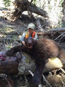 Richard McDonald's son Trenis, with his 2016 Montana spring bear, shot with a 270 Weatherby at 542 yards.