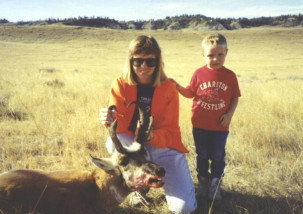 Sally and Adam with a tall buck Sally shot at about 600 yards in 1994. She shot a doe antelope on this hunt too at 955 yards with a Lilja barreled 338/416 Rigby on a Geske action.