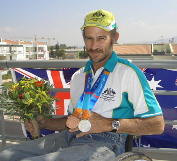 Ashley Adams of Austrailia with his Silver Medal from the 2004 Paralympics in Athens.