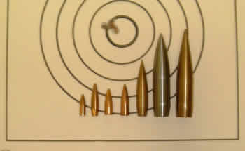 Here are several experimental bullets from a little .172 caliber to a .50 BMG  bullet made from bronze, steel and conventional jacketed/lead core types.  The target is a respectable 200 yard 5-shot Light Varmint benchrest  target fired by a Lilja barreled 6 PPC at the 2000 Cactus Classic.