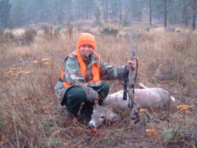 Carson with his first deer, a whitetail buck, at age 12. The rifle is a Lilja #1 contour 7mm/08 built on a Nesika T action with a Night Force 2.5-10 scope with the FC2 reticle. The stock is a McMillan by Truman Wilson.