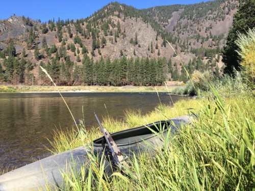 It was about a half mile downstream from this spot where I shot my ram. This is my little kayak and the lightweight 7mm-08 built on a Nesika action, Lilja #1 contour barrel, Nightforce 2.5x10 scope and McMillan stock. It weighs about 7 pounds with ammo in the magazine.