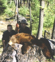 Cory Ovit with a nice brown color phase black bear that he shot on Spetember 28th 1996 - the same day he got married. Pictured with him is his cousin Joe, now an MP in the Army.