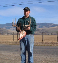 Cory Ovit holds a nice whitetail buck he shot in the 2001 Montana season. Cory laps and flutes barrels.