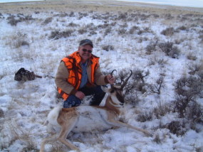 Dan with his antelope buck he snuck up on while it was in its bed. We don't hunt antelope in the snow under normal circumstances. It was quiet enough that I got to within 100 yards of this fellow while he looked the other direction. He was all by himself - no does to guard his backside.