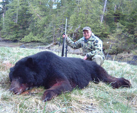 "Dan's big black bear shot on Prince of Wales Island, Alaska. This guy has a 7' - 8"" hide and an official skull score of 21 - 0/16"" making him an all-time record book Boone & Crockett black bear. The rifle is a Lilja barreled 340 Weatherby on a Remington 700 stainless steel action, McMillan stock and Night Force 2.5 x 10 NXS scope."