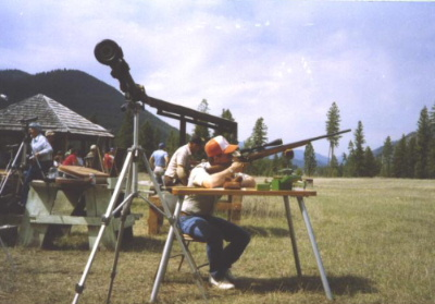 "The author lining up with his 30"" barreled .270 Weatherby Mag. The bench is an Armor Metal Products portable. Rangefinder in the foreground. Note the angle of the rifle. (This was the cover photo of Precision Shooting for this issue.)"