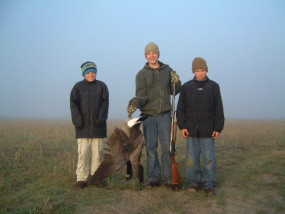 Travis, Adam and Carson after their first morning of goose hunting on opening day of 2004. We got more wing shooting over our barley field but just one goose fell on this foggy morning.