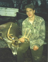 Matt Cockrell with a nice whitetail buck he shot in the 1990's.