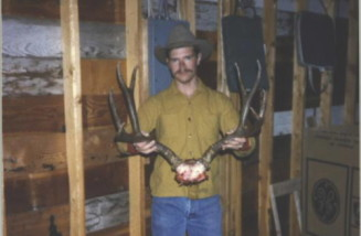 A Montana mule deer Dan shot in 1985 with a .300 Winchester Magnum and the 180 grain Nosler. Not a very good picture but a very nice heavy-horned 4-point buck.