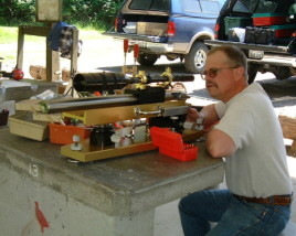 "Dan shooting his unlimited class benchrest rifle in an NBRSA match in Tacoma, Washington in June of 2000. The 2"" diameter barrel is chambered for a 6PPC cartridge."