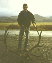 ob Horton with a dandy 6-point bull and an unusual whitetail buck. Both shot in 1996.