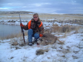 Sally with a nice 4-point mule deer she shot at 250 yards with her trusty 7mm/08.