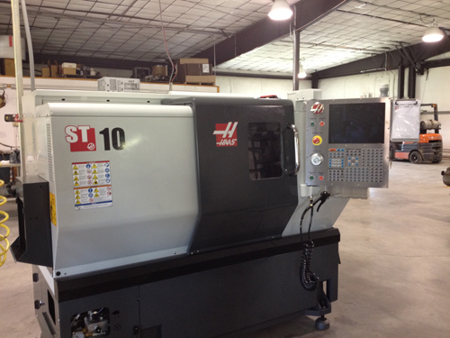 The machine work is being done on this Haas CNC turret lathe.