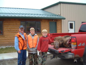 Dan, Carson and Travis with Travis' first elk, a nice big cow. We got her out in halves and loaded into the truck before noon.