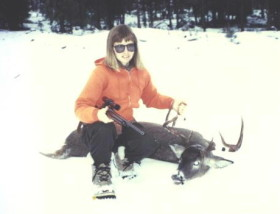 Sally with a decent 4-point whitetail around 1994. Shot with a Lilja barreled 7mm-08.
